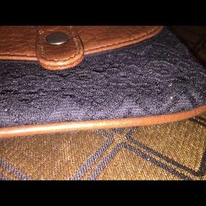 Aeropostale Bags - Black lace & faux leather wristlet by Aeropostale